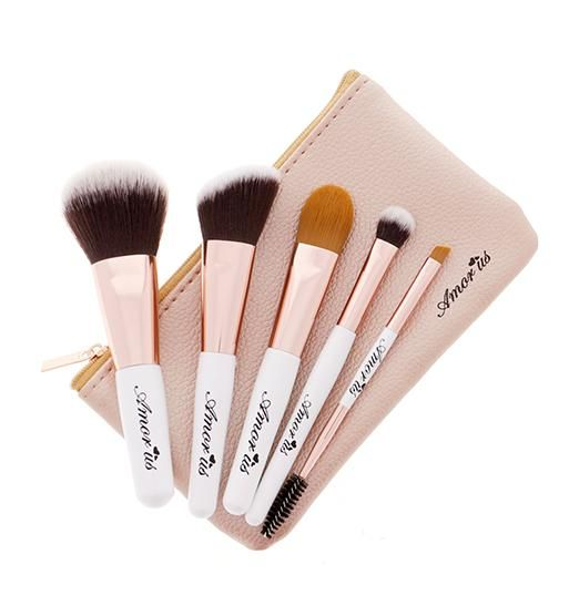 This Petite Travel Essentials Brush Set was designed to give you an effortless makeup application with these 5 must-have mini brushes featuring very soft, and dense brush heads. Pamper your skin on-the-go while applying cream, liquid or powder foundation, blush, contour, eyeshadow and brows products with this ultra soft, vegan makeup brush set; ideal for travel or a busy day. What else you'll love: - Soft Synthetic Bristles - Custom-cut brush heads - Cruelty-Free - Vegan This Brush Set Contains: - Face Powder Brush - Angled Blush Brush - Foundation Brush - Eyeshadow Brush - Angled Eyeliner and Brow Brush - Snug Brush Pouch How to Use: Apply product to the tip of the brush and blend.