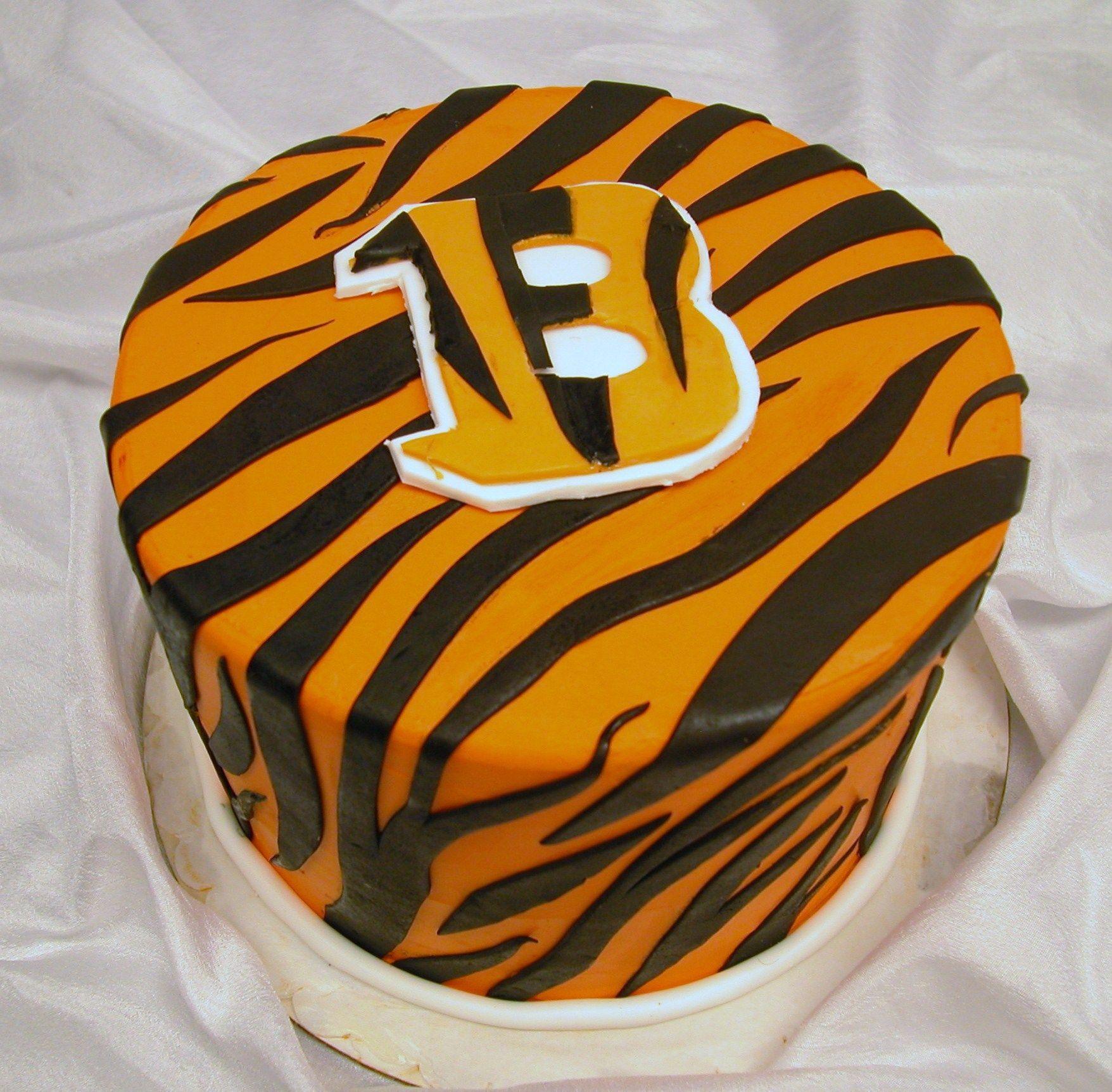 Designing His Grooms cake Cake and Wedding cake