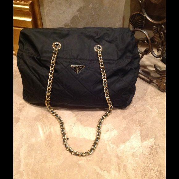 Authentic large nylon quilted Prada handbag Authentic black PRADA quilted  nylon handbag. Two gold chain 88e727b48d