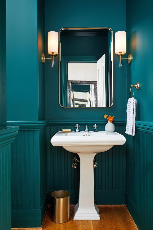 Stylish Peacock Blue Powder Room Boasts A Peacock Blue Beadboard