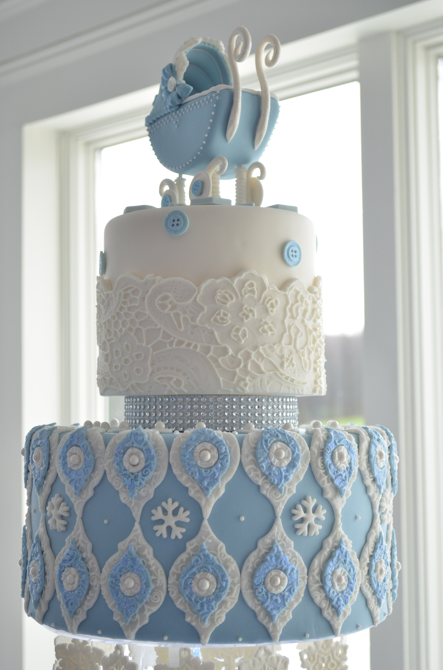 Blue Winter Wonderland cake for boy's baby shower with gumpaste baby  carriage, sugar snowflakes, lace overlays