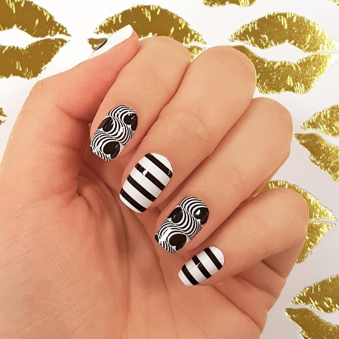 """Madly in Love"" nails are black and white and have hearts and stripes all over, for an unexpected take on a Valentine's Day mani! #incoco #nailart #valentinesdaynails #heartnail #blackwhitenails"