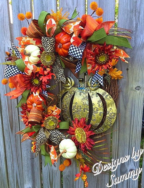 Fall Pumpkin grapevine Floral Wreath, Fall Sunflower and Pumpkin Wreath, Fall Pumpkon Decor, Fall Front Door Decor  This one of a kind Fall wreath is the perfect statement piece to set off your front porch this Autumn season! With its warm fall colors and rich floral accents, its sure to have the neighbors talking! You will love how impressive this oblong shaped wreath is! It has many different high quality elements that include a bronze rubbed metal Pumpkin, burgundy sunflowers, shiny burnt…