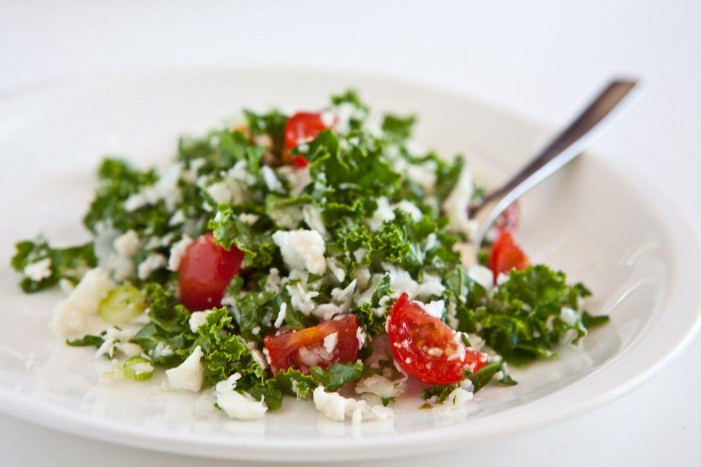 kale and cauliflower salad with lemon, garlic and cherry tomatoes