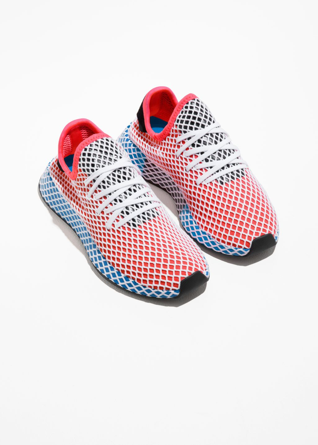04fb1bc8b Back image of Stories adidas deerupt runner in red