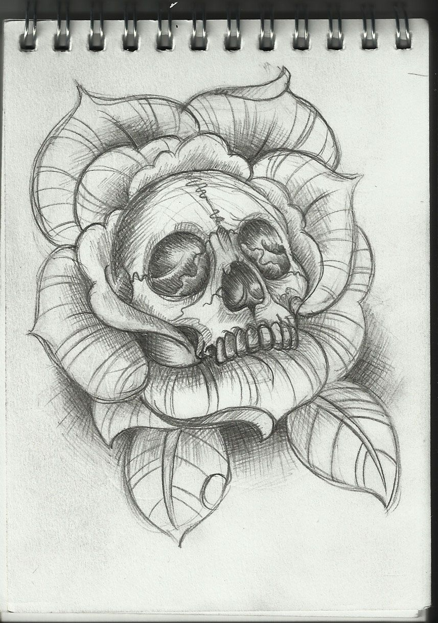 skull inside of a rose tattoo design Skull tattoo design