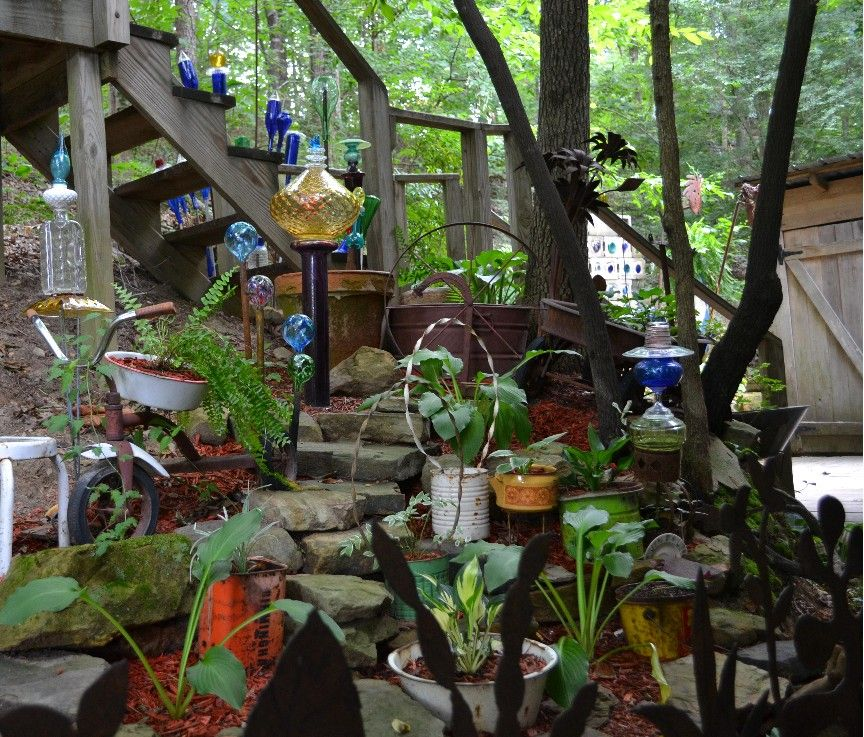 Eclectic garden from recycled items art and interest for Recycled garden art ideas