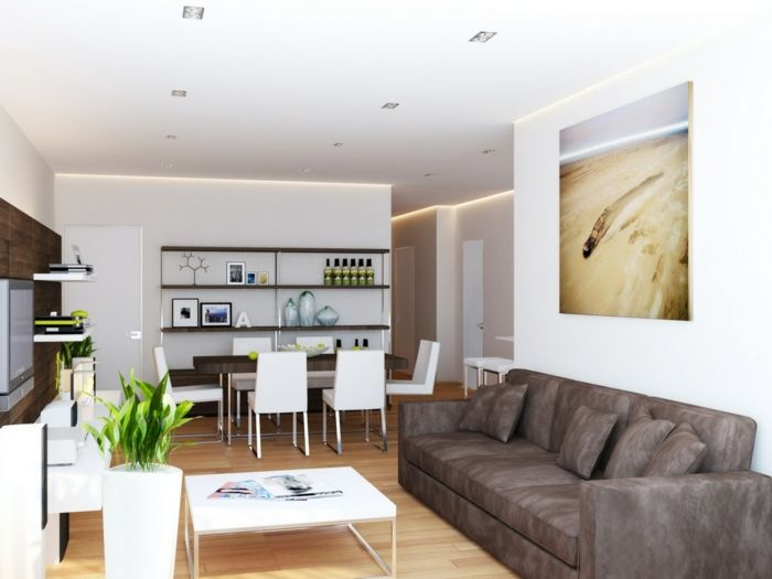 Innendesign Wohnzimmer Weiße Wandfarbe Dunkles Sofa Pflanzen