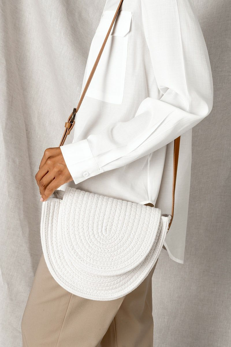 Download Download Premium Image Of Black Woman Carrying A White Woven Cotton Rope