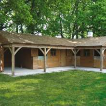 Secluded wooden stables and wooden barn