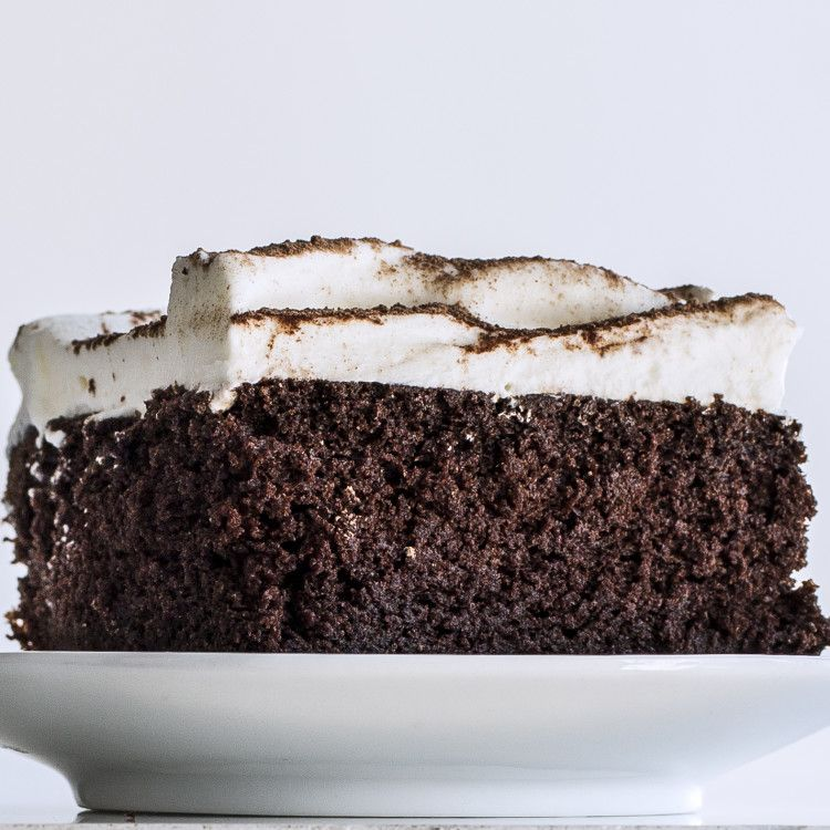 """The genius part of this rich and moist cake is the """"reverse creaming"""" method. Instead of creaming butter and sugar before adding the liquid ingredients and flour, you'll gradually add the liquid ingredients into the flour. As a result, the cake bakes almost perfectly flat—no domed tops, no layers to trim."""