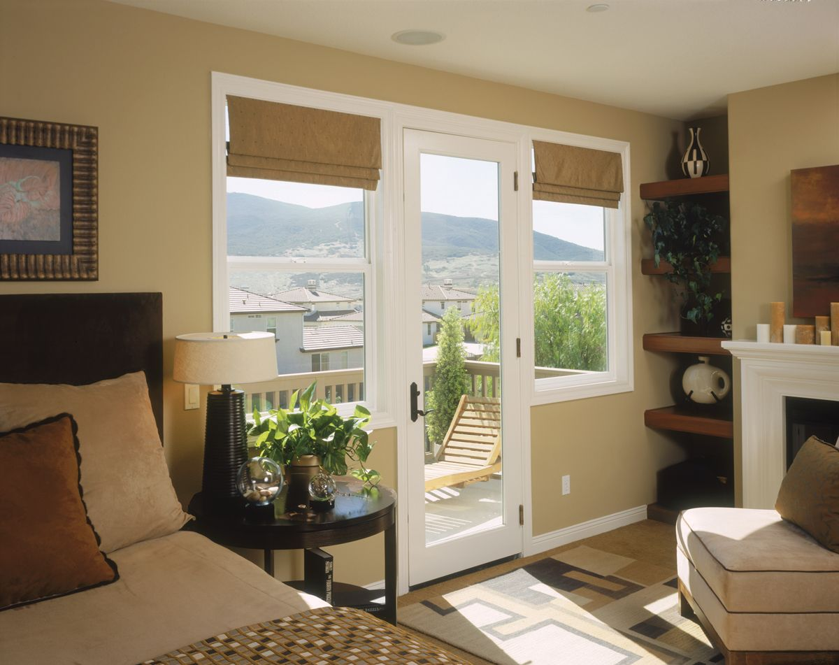 Patio door and windows without grids let in a lot of light for French doors without windows