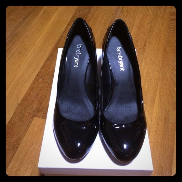 Size 9 Wide Great Condition Heels These shiny black approximately 3 inch wedge heels look great with everything! They are LaneBryant brand and in great condition. They have one small scuff on the front of the left heel. Lane Bryant Shoes Wedges