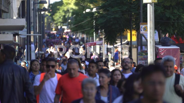 Mexico City downtown Crowd of people walking busy street scene Stock Footage CrowdpeopledowntownMexico