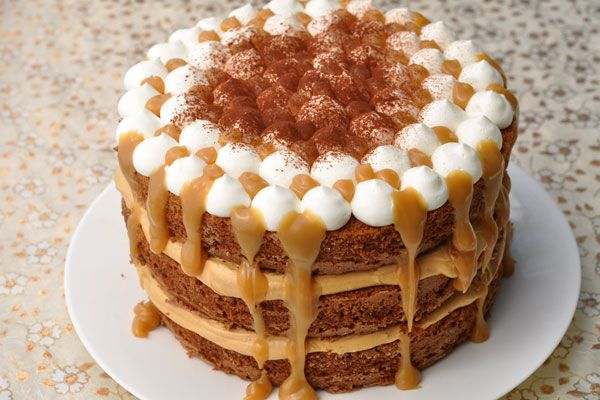 Latte Cream Cake | Coffee cream layered between milk chocolate cinnamon cake. Topped with whipped cream and caramel