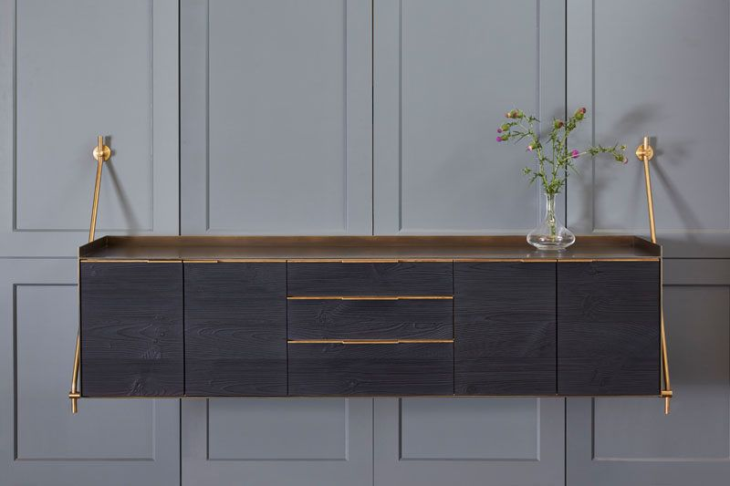 This Charred Pine And Bronze Credenza Hangs From The Wall Meuble Bois Decoration Interieure Et Credence