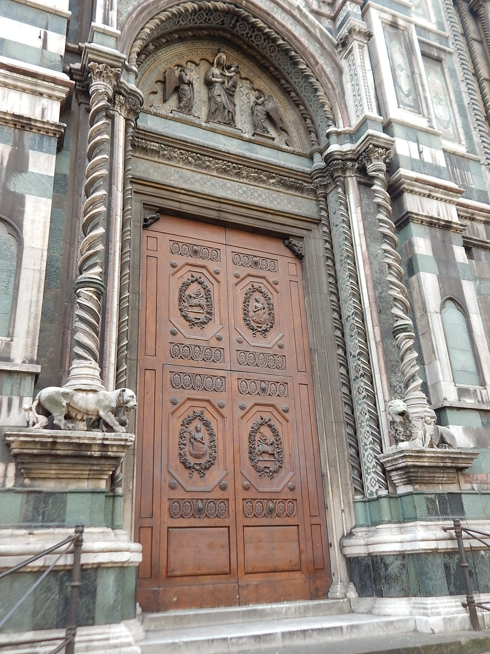 Finely detailed decorations sets off this cathedral doorway in #Florence