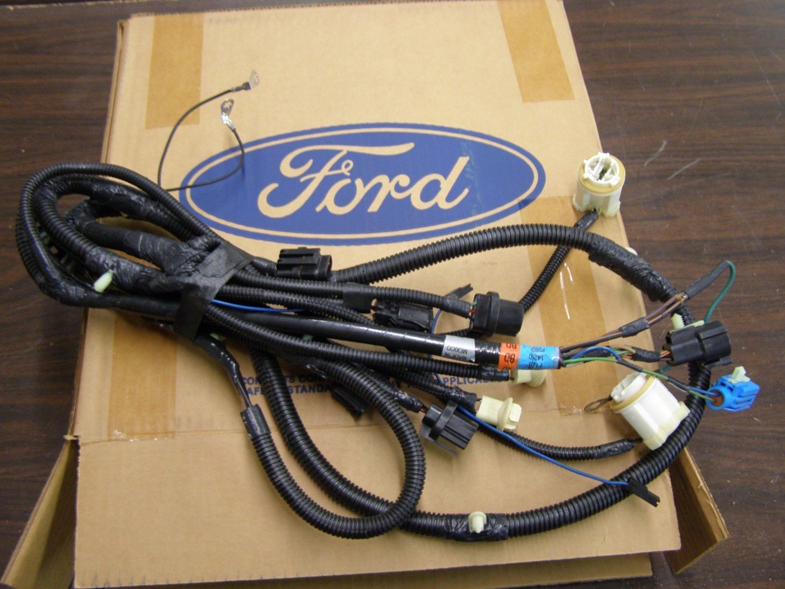 up for auction is a nos under hood (dash panel to headlight) wiring harness  for a 1991-1993 mustang with a v8 motor (also 1993 cobra)