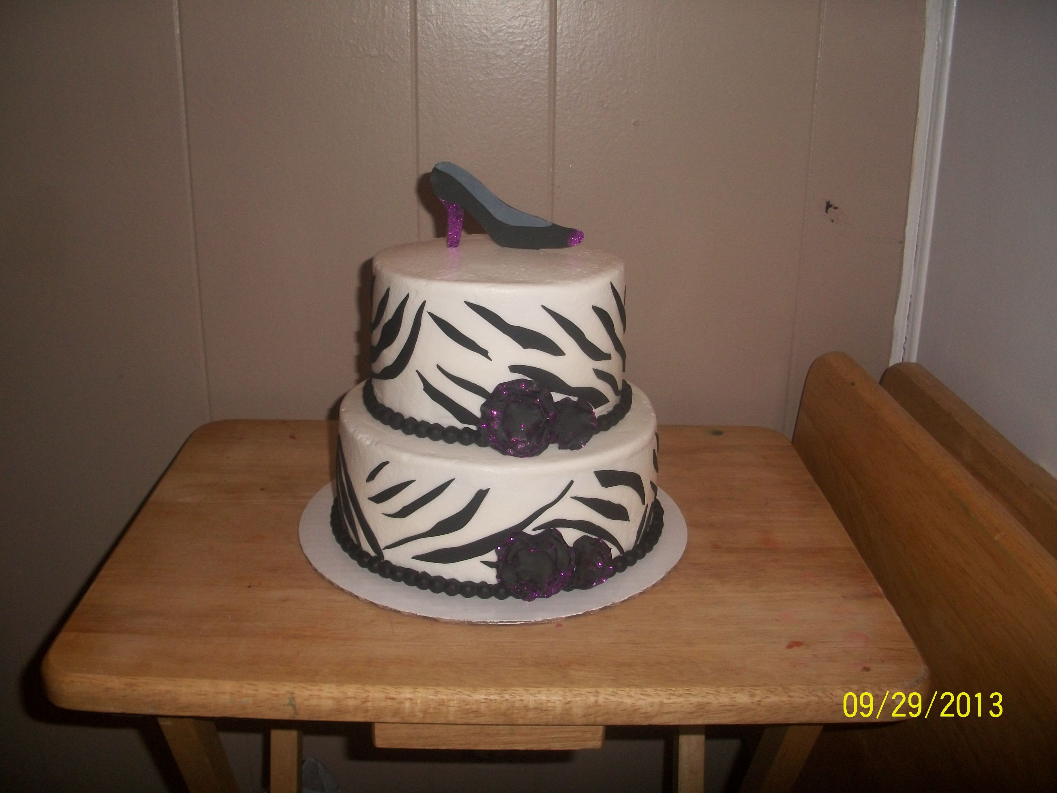 - Zebra cake with gumpaste shoe topper
