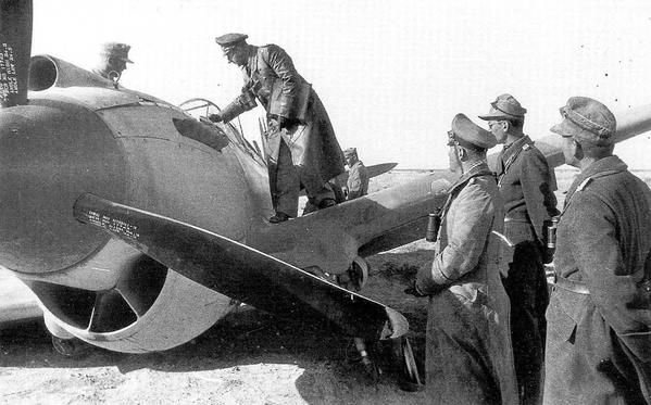 Erwin Rommel and his officers inspect a P-40 Kittyhawk shot down in the desert, North Africa, 1940