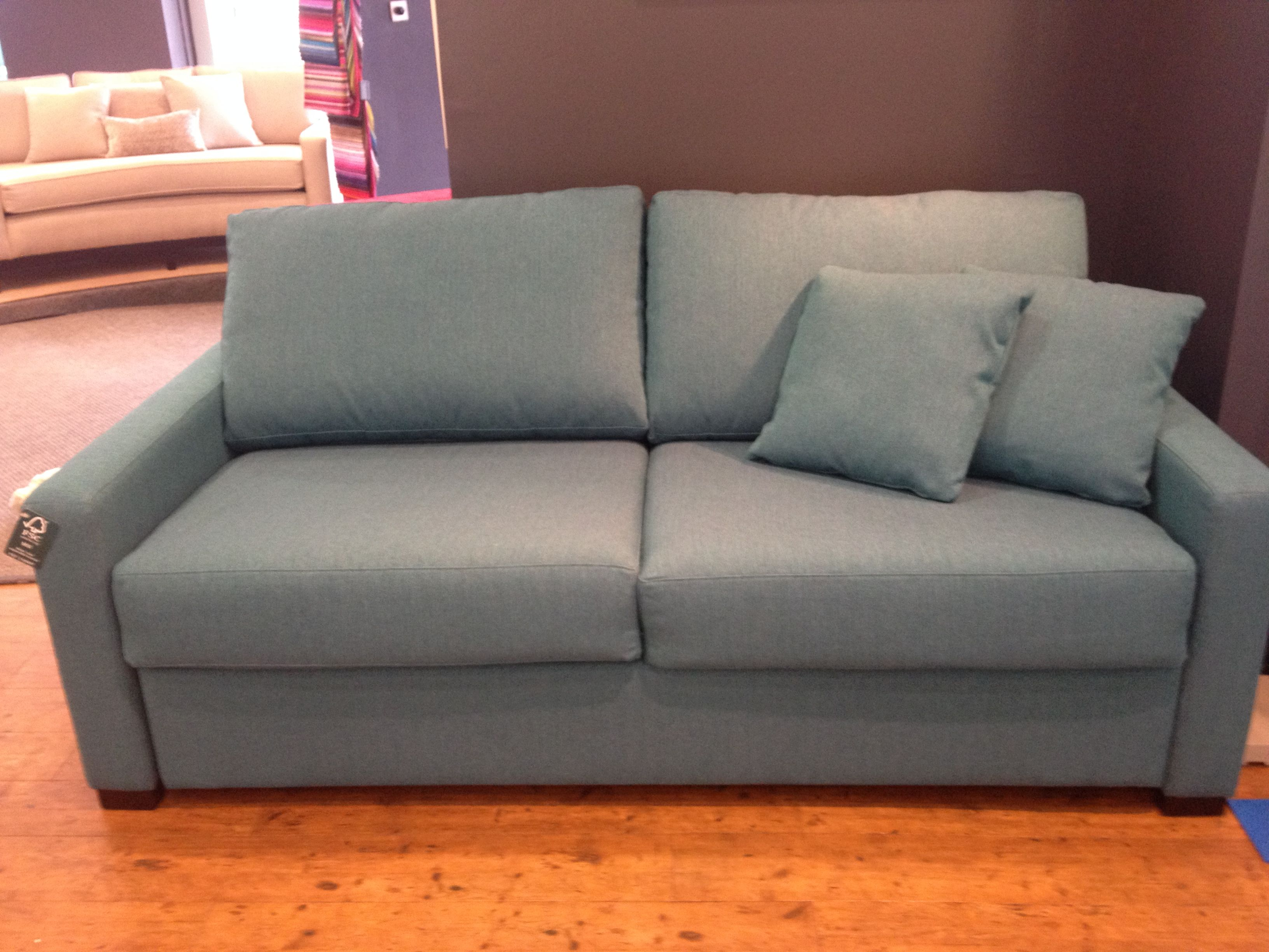 Turquoise fabric covered sofa bed, 186 cm width using the ...