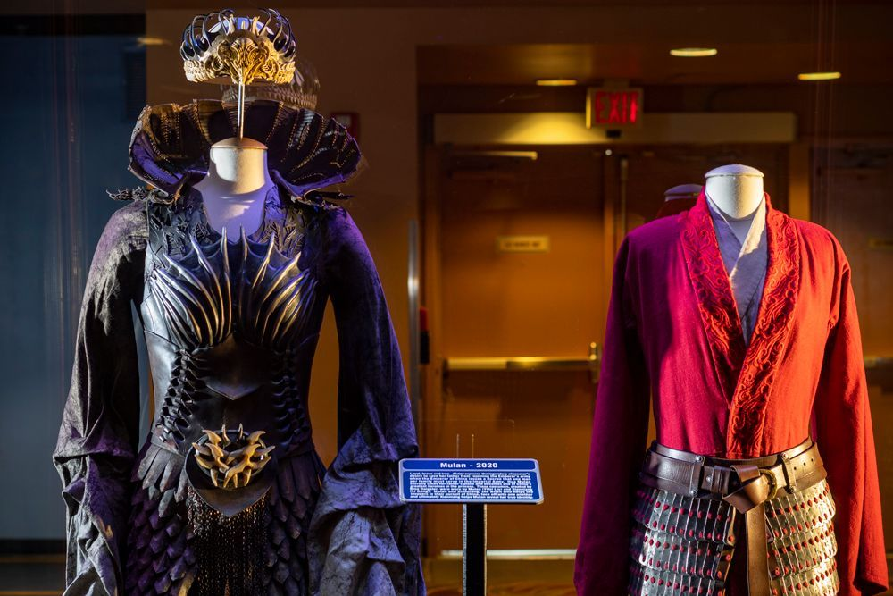 Mulan Costumes And Props On Display At Disney World Inside The Magic In 2020 Hollywood Studios Disney Disney Movie Releases All Disney Movies
