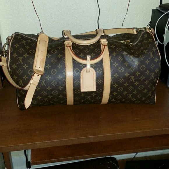 be2bbdbdd6b3 Authentic Louis Vuitton Keepall Bandouliere 55 Perfect bag used twice!  Dark