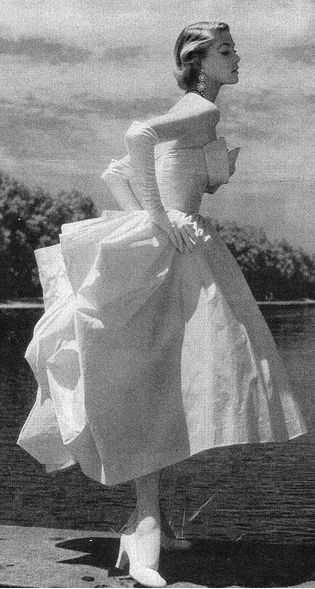 1950 Jean Patchett in short evening dress with folded bustle effect by Ceil Chapman, photo by Toni Frissell, Washington D.C., Vogue, October #vintagefashion1950s