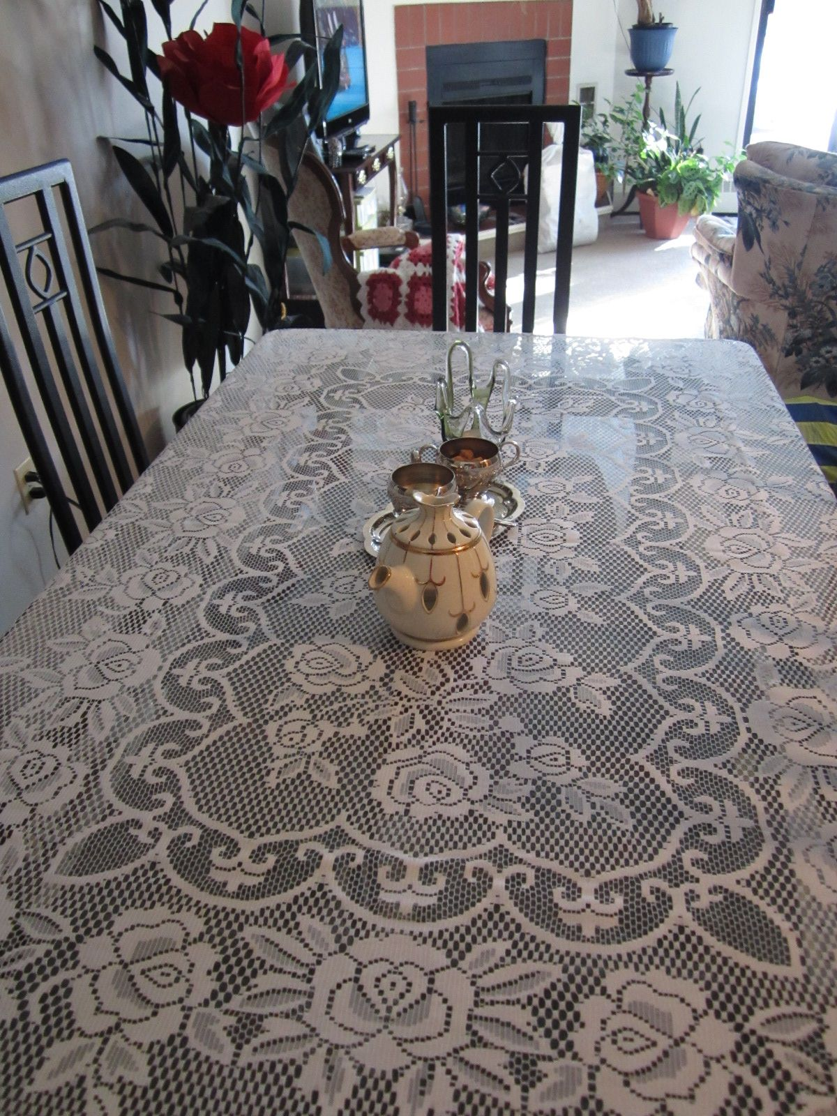 Long black beveled glass dining table.