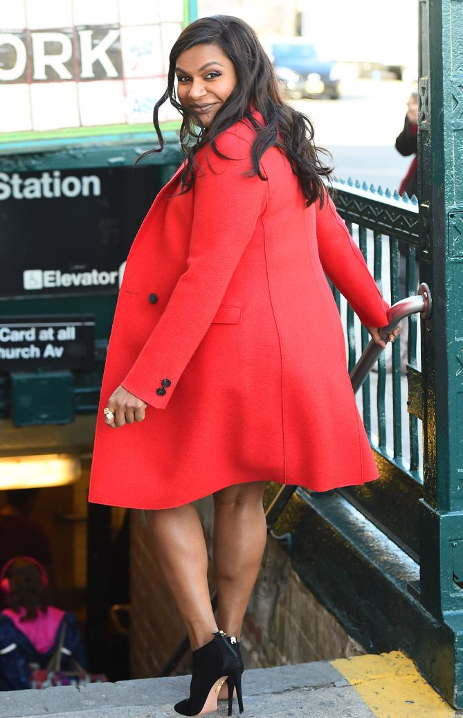10d020a7a662c Mindy Kaling in a red coat - click ahead for more celebrity winter outfits!