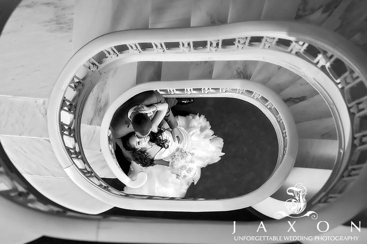 Bride and groom sharing an intimate moment in the staircase at the