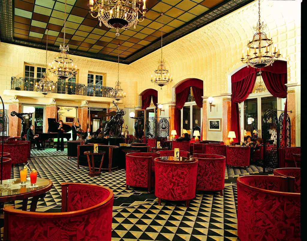Art Deco Interior Design With Red Seats And Cool Ceiling Floor At Lutetia Bar