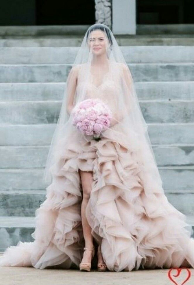 Pink wedding dress///I love that she\'s wearing the veil over her ...