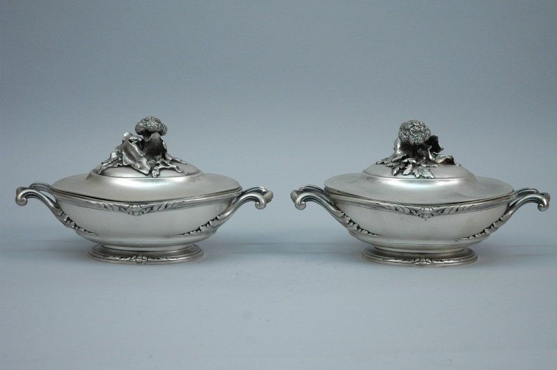 Only one pair in stock of this item shown. Pair of French 950 Silver Covered Vegetable Dishes Contact: 646-863-5416 This is a pair of heavy gauge antique 950 silver vegetable dishes, beautifully made by the esteemed French silversmith, G. Keller of Paris, and handsomely embellished on the lids with superbly crafted depictions of broccoli stalks and leaves. Each of the dishes consists of 3 parts; an elegantly curving body with a pair of carrying handles, a removable gilded insert for ease in…