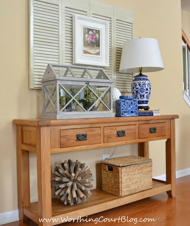 Family Room Decor Layering Accessories On A Console Table