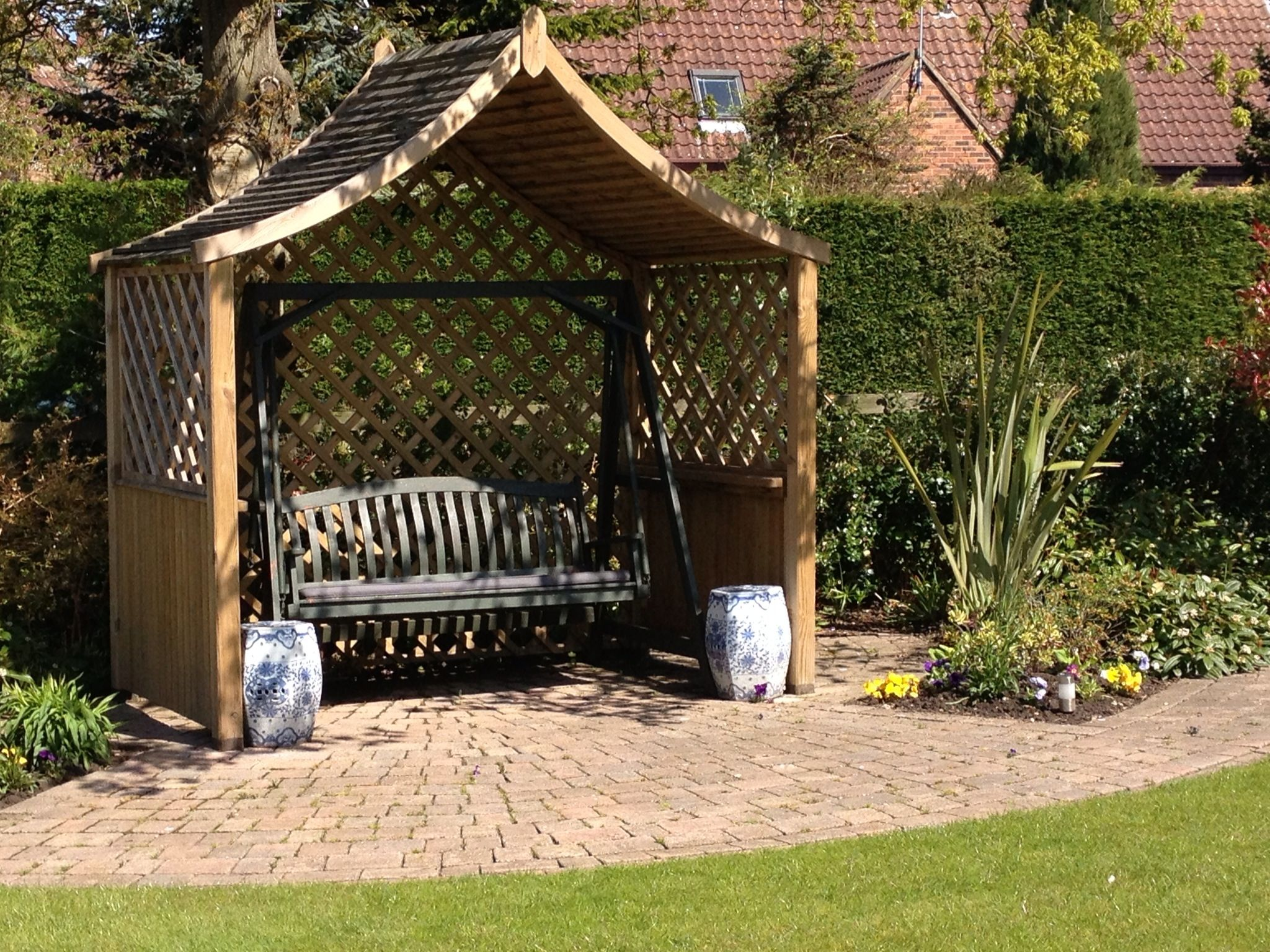 We designed and built this arbour to fit our clients swing ...