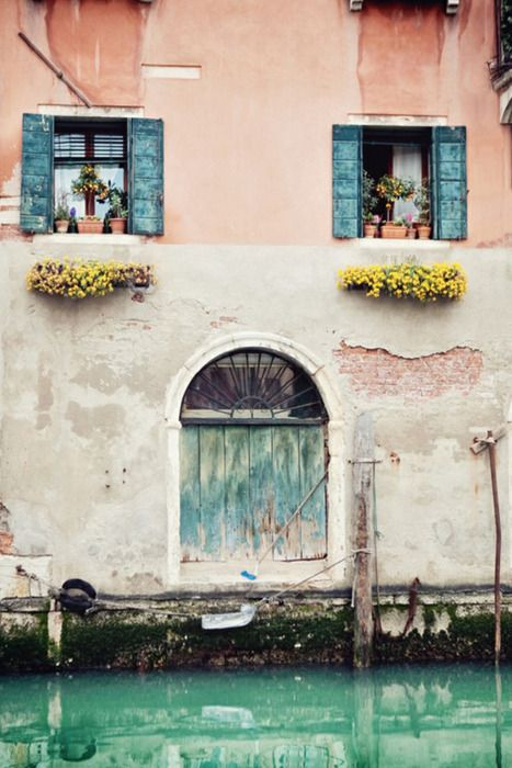 venice - always & forever. the pastel colors take my breath away. look at this old building with the blue shuttered windows and the blooming flower pots