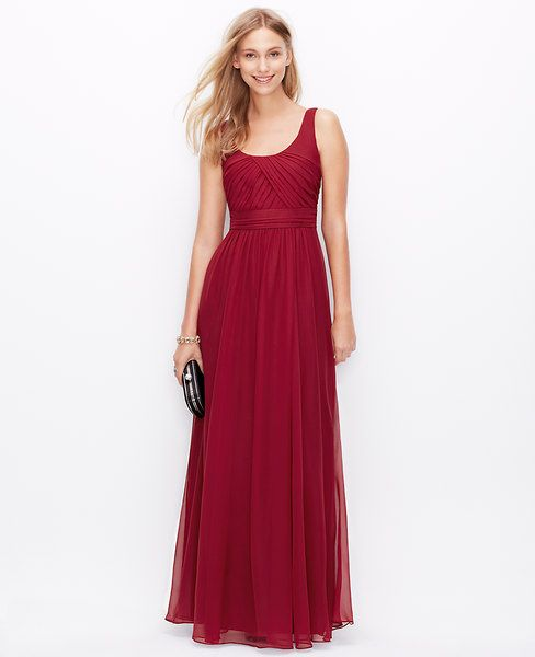 """Exquisitely draped in lightweight silk georgette, this gorgeous gown flaunts an intricately tucked bodice for a couture-worthy finish. Scoop neck. Sleeveless. Tucked bodice. Pleated inset waistband. Scoop back. Hidden back zipper with hook-and-eye closure. Lined. 45"""" from natural waist. </p> <p> <br /> <br /> <em><span style=""""color: purple;"""">Items in our Weddings """" Events Collection can only be exchanged or returned by mail. <br /></span></em></p>"""