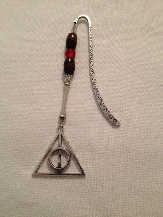 Check out this item in my Etsy shop https://www.etsy.com/ca/listing/265661336/hp-deathly-hallows-bookmark