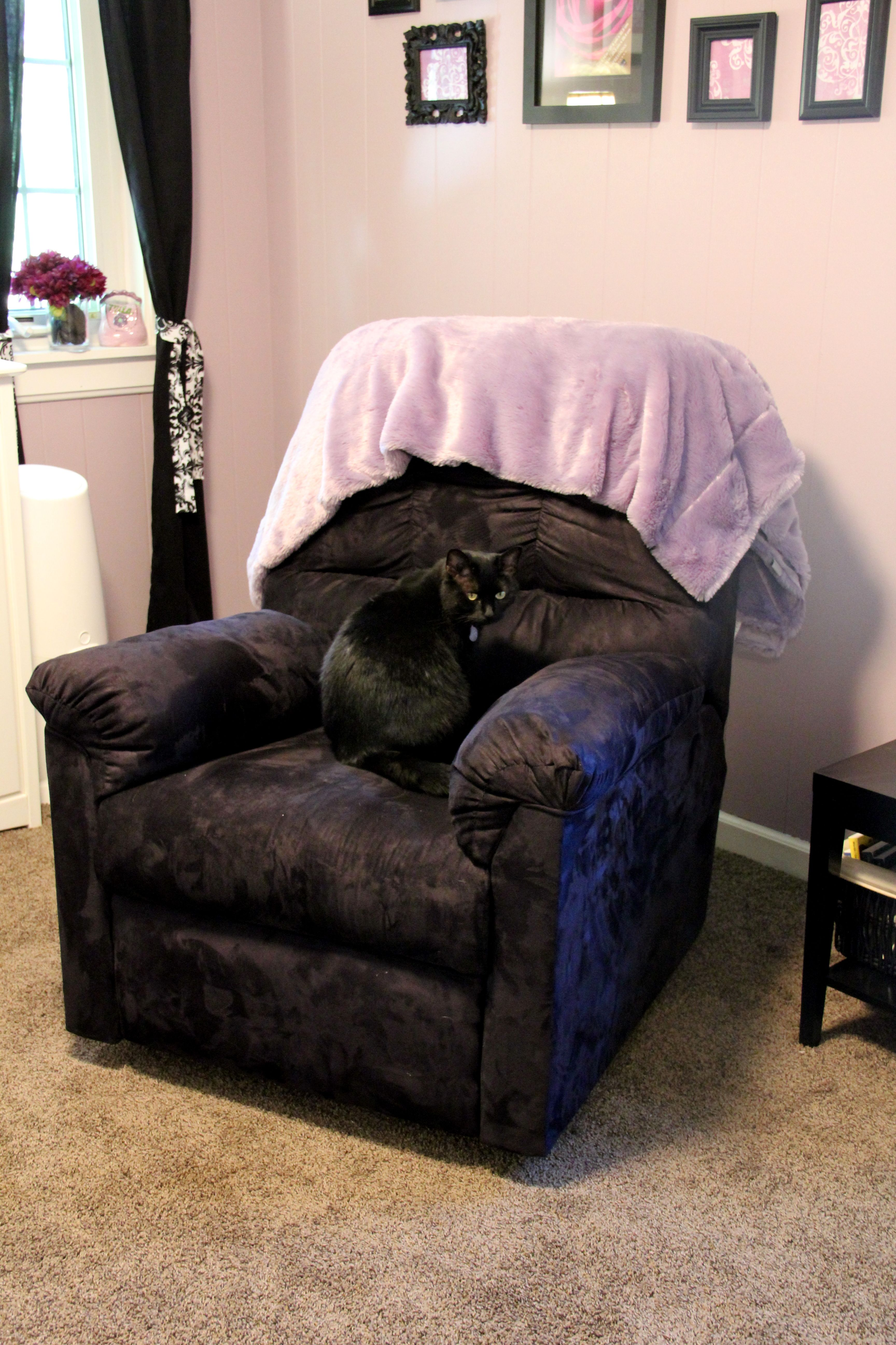 Oversized chair from Ashley Furniture purple throw from