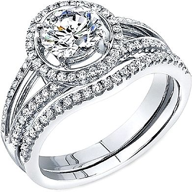 Simon G Split Shank Diamond Halo Engagement Ring  : This diamond engagement ring by Simon G has a split shank with pave set diamonds. There is also a pave set diamond halo that is made specially to fit around the diamond of your choice.