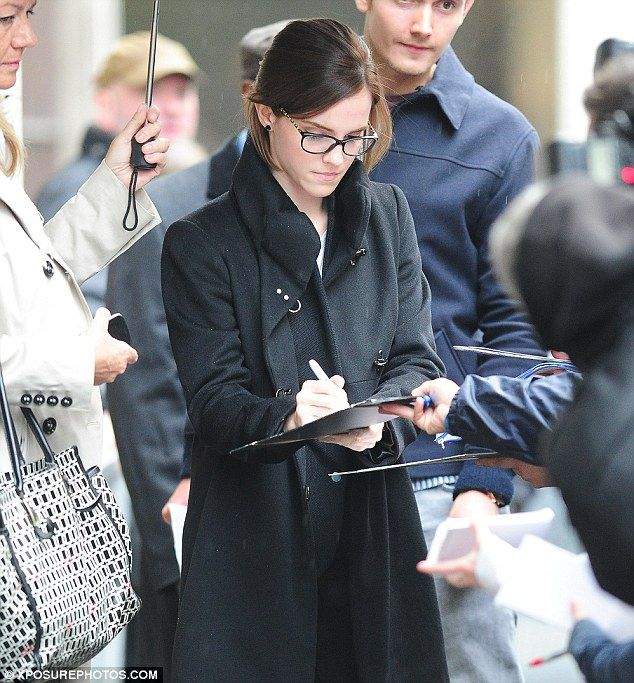 Meeting and greeting: Emma took the time to sign autographs for her waiting fans as she left the interview and headed to a press junket for the movie