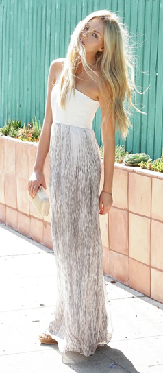 I love this maxi dress! The subtle grey and white tones somehow manage to be so summery with her boho waves. If only I could replace her clutch with one from my collection this outfit would truly be to die for xx