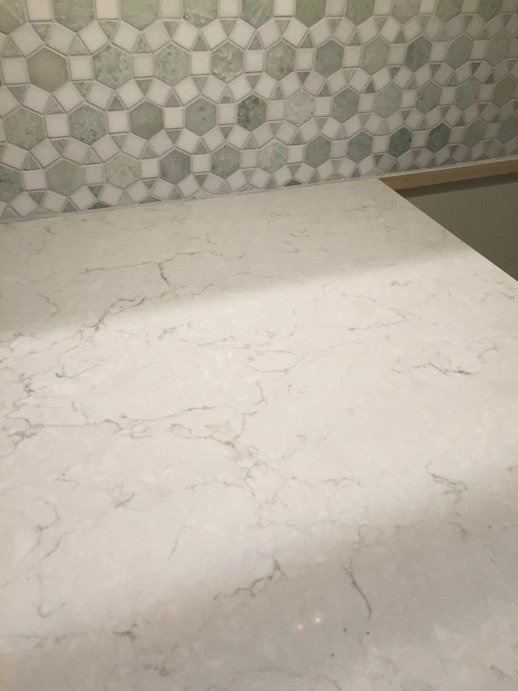 Snowy ibiza silestone countertop for our new kitchen for Silestone vs granite