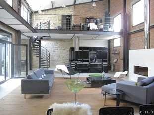 92 très beau loft dans un style industriel. grand salon double