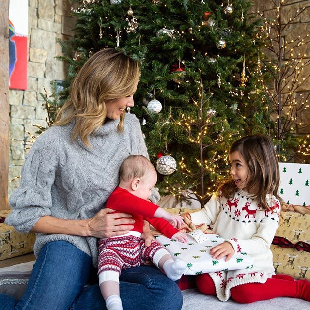 Retired WWE Diva Stacy Keibler opening gifts on Christmas ...