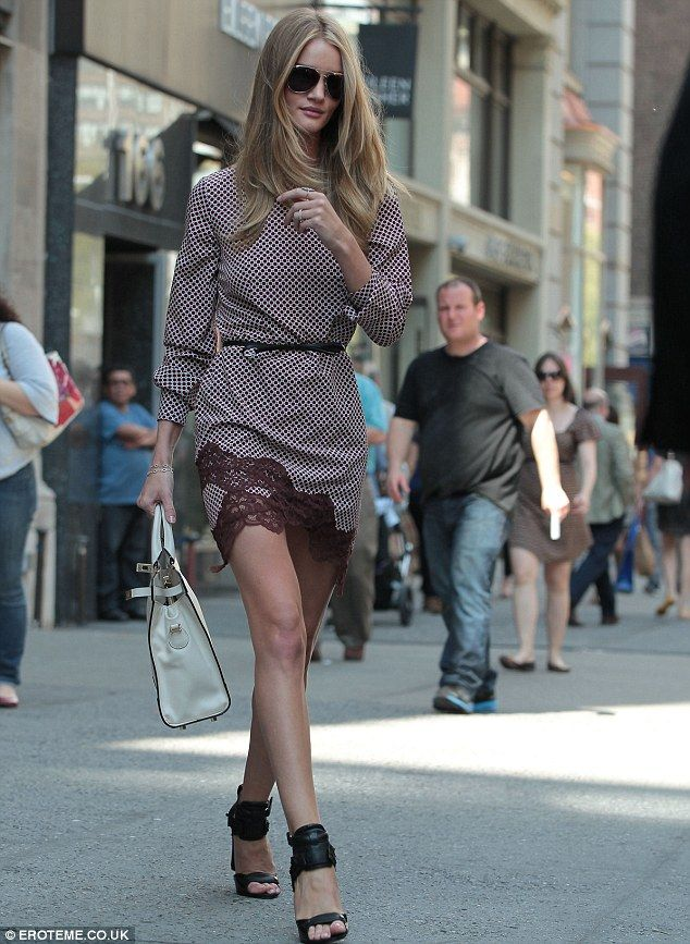 Rosie Huntington-Whiteley displays her mile-long legs in a frilly mini-dress and bondage heels