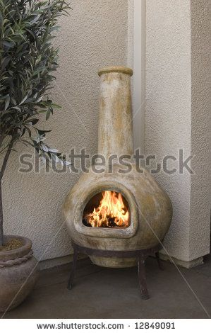 Small Outdoor Patio Fireplace Kiva Design By Shippee Via Shutterstock Patio Fireplace Standing Fireplace Small Outdoor Patios