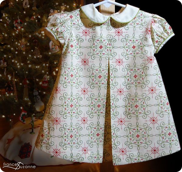 Well, CL finally has a Christmas outfit of her own…..instead of her sister's seconds! We found the neatest, vintage Christmas print {Moda Nature's Gift, Snowy White by Deb Strain} duringaJune fabric trip….and promptly boughtand stored it away. We used the Children's Corner, Carol pattern (hence, the title of this blog)- UNmodified. Sure, in hindsight, we …
