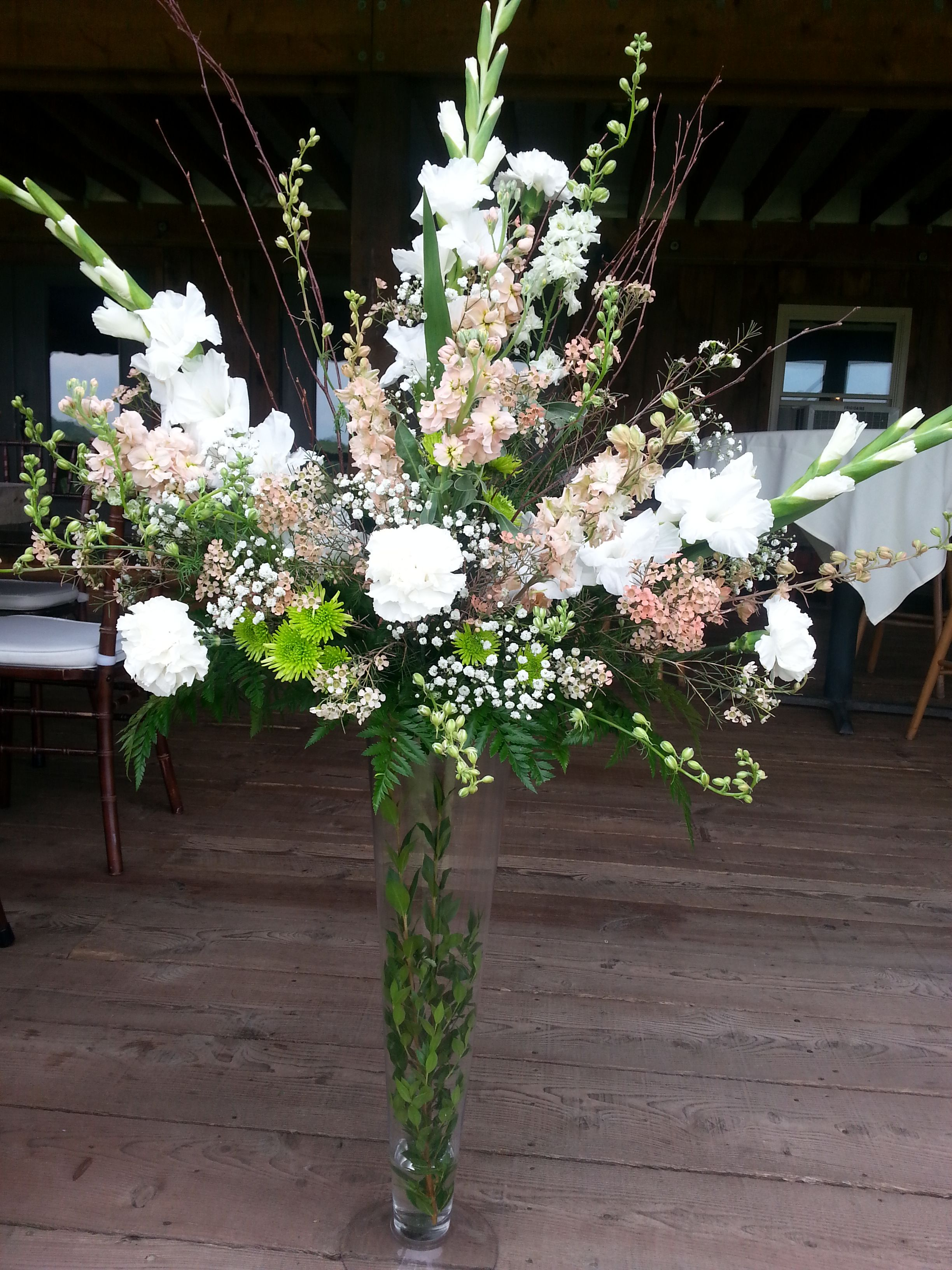Gorgeous Centerpiece With White Gladiolus, Carnations, And Babys Breath